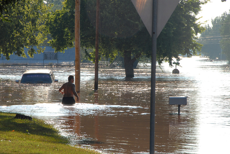Man wading through flood